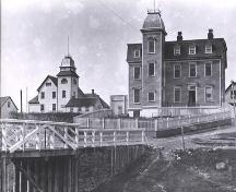 Historic photo view facing the Loyal Orange Lodge (at left) and Court House in Bonavista, some time post-1911; HFNL 2006