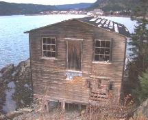 Exterior view of facade of Wicks Store at Wicks' Point, Jackson's Arm, NL, 2005/11/16.; L Maynard/HNFL, 2005
