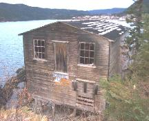 Exterior view of facade and side of Wicks Store at Wicks' Point, Jackson's Arm, NL, 2005/11/16.; L Maynard/HNFL, 2005