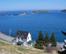 View looking east of Historic Ferryland Museum, Ferryland, NL with Ferryland Harbour in the background. Photo taken May 2006.; HFNL/Andrea O'Brien 2006