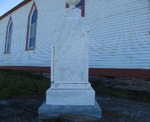 View of Monument to the victims of the 1892 Trinity Sealing Disaster, located within the cemetery of the All Saint's Anglican Church, English Harbour, NL.; HFNL 2005.