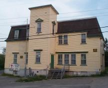 View of front and right facades, St. George's Court House, St. George's, NL, prior to restoration in 2004, showing missing tower roof.; HFNL 2005