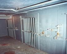 Interior photo showing jail cells, St. George's Courthouse, NL.  Cells were used to hold prisoners when making court appearances.  Photo taken around 2004, prior to restoration.; HFNL 2006