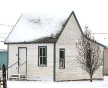 View of Beecher House at the Prairie Pioneer Museum highlighting the small scale and vernacular form of the building, 2006.; Saskatchewan Architectural Heritage Society, Frank Korvemaker, 2006.