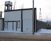 View of front facade highlighting the bell tower, 2004.; Government of Saskatchewan, James Winkel, 2004.