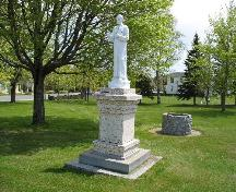 The monument adorned with a plaque that briefly describes the life and work of Father Lafrance.; Town of Tracadie-Sheila