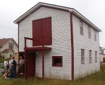 Exterior photo of the Wakeham Sawmill, Placentia, NL, showing main entrance, taken during Doors Open Placentia event, 2004.; HFNL 2005