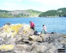 Archaeologists conducting a survey of the shoreline at Blacksmith, Fermeuse, NL. ; Peter Pope 2000/ HFNL 2006
