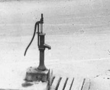 Black and white image of the pump without the trough; Elizabeth Toy