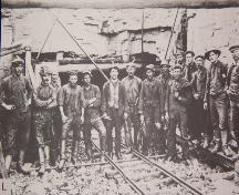 Dominion Company miners at the collar of the No. 2 Mine (above ground opening to the mine).  Date unknown, possibly 1920s.; No. 2 Mine and Museum, 2006