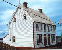 Exterior side and front view of James Ryan Tenement House, Bonavista, circa 2004, after restoration; HFNL 2004