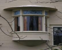 Detail of the oriel window with curved glass in the east side of the William L. Lovitt House.; Heritage Division, NS Dept. of Tourism, Culture & Heritage 2006