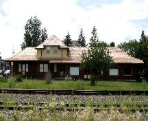 View of station from across railway tracks highlighting the roofline and window locations, 2005.; Saskatchewan Architectural Heritage Society, Kyle Zelmer, 2005
