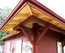 View of the broad overhanging eaves and brackets typically found on railway stations, 2005.; Saskatchewan Architectural Heritage Society, Kyle Zelmer, 2005
