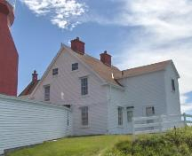 Northern facade of Long Point Lightkeeper's Double Dwelling, Crow Head, NL. Photo taken August 2006. ; HFNL 2006