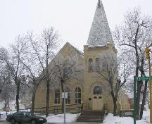 View of  St. Paul's Lutheran Church featuring the corner tower and rounded-arch windows, 2004.; Government of Saskatchewan, B. Flaman, 2004