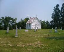 View highlighting the vernacular architecture of the Church and the close proximity to the cemetary, 2006; Dwayne Yasinowski, 2006.
