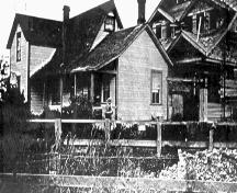 The 1st and 2nd Parmiter Houses, while 2nd (at right) was under construction and before the 1st was relocated, circa 1919; Delta Museum and Archives, #1970-1-491