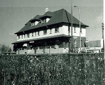 Corner view of Canadian Pacific Railway Station, showing both the front and side façades.; Smithers, 1980.