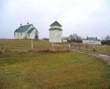 View southeast showing relationship to adjacent church and bell tower, 2005.; Government of Saskatchewan, Marvin Thomas, 2005.