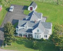 Aerial view of the Sylvain Gaudet House which reveals the rather irregular architectural style of the structure; Memramcook Valley Historical Society