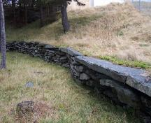 View of stone wall surrounding the Mother M. Bernard Kirwan Memorial. Photo taken December, 2005.; HFNL/Andrea O'Brien 2005