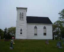 South elevation and cemetery, St. Stephen's Anglican Church, Tusket, Nova Scotia, 2004.  ; Heritage Division, NS Dept. of Tourism, Culture and Heritage, 2004.