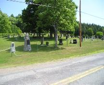 Bard John MacLean Cemetery, with Bard John Maclean's stone rubble monument in the foreground, Glen Bard, Nova Scotia, 2005.; Heritage Division, NS Dept. of Tourism, Culture and Heritage, 2005.