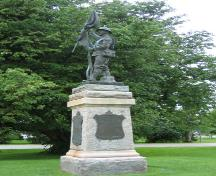 "Established in 1921, the 9 ft. bronze sculpture features a soldier holding aloft a ""flag of victory""; Province of PEI, Darin MacKinnon, 2005"