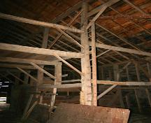 View of the interior timber framework of the Graham Barn, Minto area, 2004; Historic Resources Branch, Manitoba Culture, Heritage and Tourism, 2005