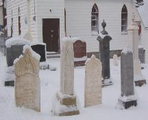 Photo of gravemarkers at Heyfield Memorial United Church Cemetery, Heart's Content, 2007/01/10.; L Maynard, HFNL 2007
