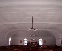 Interior photo view of of Heyfield Memorial United Church, from rear, facing altar, showing decorative tin on ceiling and walls, 2007/01/10; L Maynard, HFNL 2007