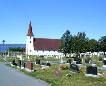 View of St. John the Evangelist Church with cemetery in foreground. Photo taken July 2006.; Kim Barnes/ HFNL 2007
