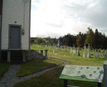 Photo of St. John the Evangelist Cemetery with church in left corner. View looking east, photo taken October 2006.; Kim Barnes/ HFNL 2007