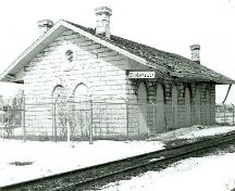 Corner view of the Former Grand Trunk Railway Station, showing both the back and side façades, 1992.; M. Carter, 1992.