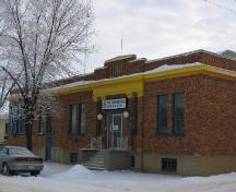 Front Facade of Sask Tel Building in Melfort highlighting the brick and stone detailing, 2007.; Government of Saskatchewan, Bernard Flaman, 2007.
