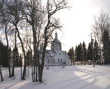 Contextual view, from the northeast, of St. Nicholas Ukrainian Catholic Church, Rackham area, 2006; Historic Resources Branch, Manitoba Culture, Heritage and Tourism 2005