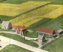 Older aerial view looking north - Harshman Boarding House is the red house in the left side of the photo; Village of Cap-Pelé