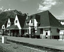 Corner view of Canadian National Railway Station, showing both the back and side façades, 1991.; Great Plains Research Consultants, B. Potyondi, 1991.