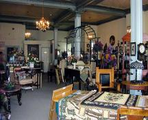 Interior view of the large second floor antiques shop – c. 2000; baldachin.com, 2002