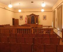 Interior image of the Shaunavon Courthouse highlighting the wood trim in the court room, 2006.; Government of Saskatchewan, Bernard Flaman, 2006.
