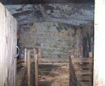 "Interior photo view of the Tom Porter Root Cellar, Elliston, NL, 2007; showing steel beam from the ""Eric"" 1870s shipwreck used in construction; Tourism Elliston Inc., 2007"