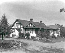Exterior southwest view of the Allen Bungalow and garden (circa 1940); Red Deer and District Archives – Call No. PA 004-1