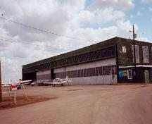General view of BCATP Hangar No 1, showing north elevation, 1999.; Stephen Hayter, Commonwealth Air Training Plan Museum, Inc., 1999.