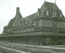 View of the west elevation of the railroad station, 1973.; Parks Canada Agency/Agence Parcs Canada, 1973.
