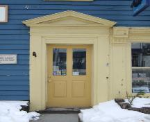 This photograph shows the entrance with pediment and illustrates one of the pilasters that flanks the storefront window, 2007  ; Town of St. Andrews