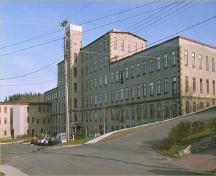 General view of Rosamond Woollen Mill, 1991.; Parks Canada Agency/Agence Parcs Canada, 1991.