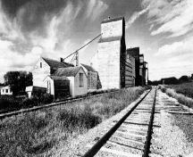 General view of the Inglis elevators, ca.1996.; Heritage Recording and Technical Data Services, HCP, RPS, ''Preliminary Record of 5 Grain Elevators, Inglis, Manitoba'', September/October 1996, photo 07526/23.