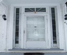 This photograph illustrates the transom window, sidelights and ornate wood door, 2007; Town of St. Andrews