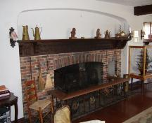 This photograph shows the fireplace and the 2.5 metre mantle with hand carved poetry, 2007; Town of St. Andrews